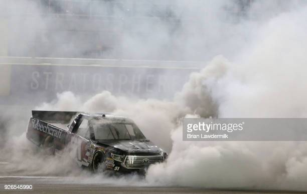 Kyle Busch driver of the Cessna Toyota celebrates with a burnout after winning the NASCAR Camping World Truck Series Stratosphere 200 at Las Vegas...