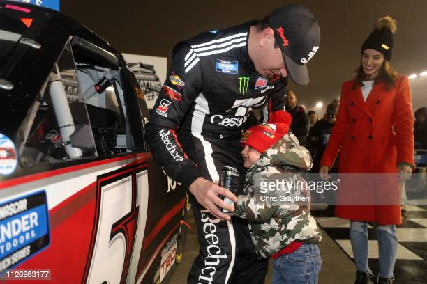 Kyle Busch driver of the Cessna Toyota celebrates with his son Brexton after winning the NASCAR Gander Outdoors Truck Series Ultimate Tailgating 200...