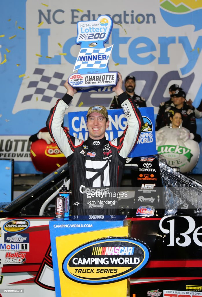 Kyle Busch, driver of the #51 Cessna Toyota, celebrates with the trophy after winning the Camping World Truck Series North Carolina Education Lottery 200 at Charlotte Motor Speedway on May 19, 2017 in Charlotte, North Carolina.