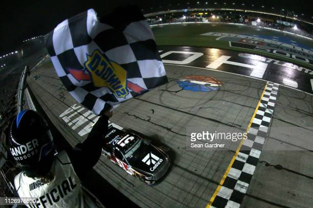 Kyle Busch driver of the Cessna Toyota crosses the finish line to win the NASCAR Gander Outdoors Truck Series Ultimate Tailgating 200 at Atlanta...