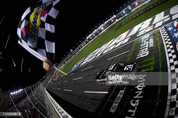 Kyle Busch driver of the Cessna Toyota crosses the finish line to win the NASCAR Gander Outdoors Truck Series North Carolina Education Lottery 200 at...