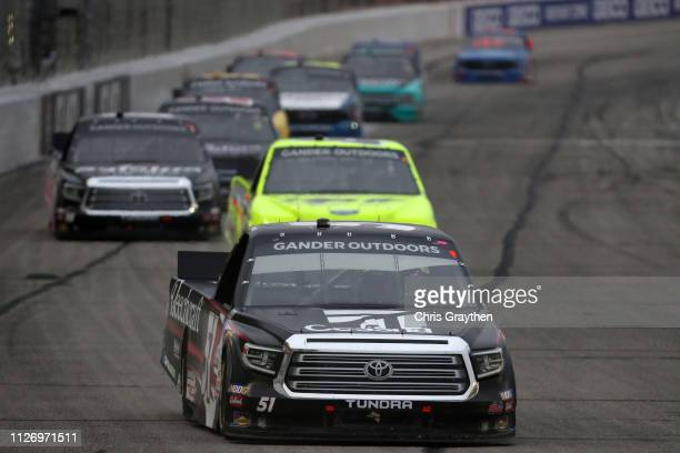 Kyle Busch driver of the Cessna Toyota leads a pack of cars during the NASCAR Gander Outdoors Truck Series Ultimate Tailgating 200 at Atlanta Motor...