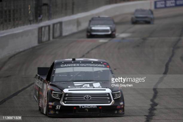 Kyle Busch driver of the Cessna Toyota leads during the NASCAR Gander Outdoors Truck Series Ultimate Tailgating 200 at Atlanta Motor Speedway on...