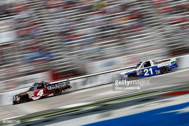 Kyle Busch driver of the Cessna Toyota leads Johnny Sauter driver of the Allegiant Airlines Chevrolet during the NASCAR Camping World Truck Series...