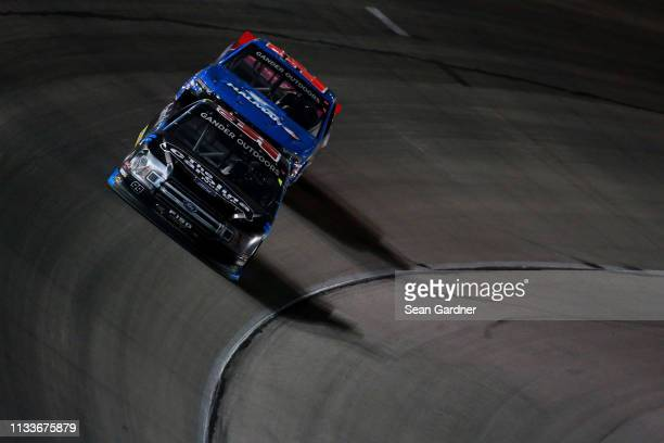 Kyle Busch driver of the Cessna Toyota leads Stewart Friesen driver of the Halmar International Chevrolet during the NASCAR Gander Outdoors Truck...
