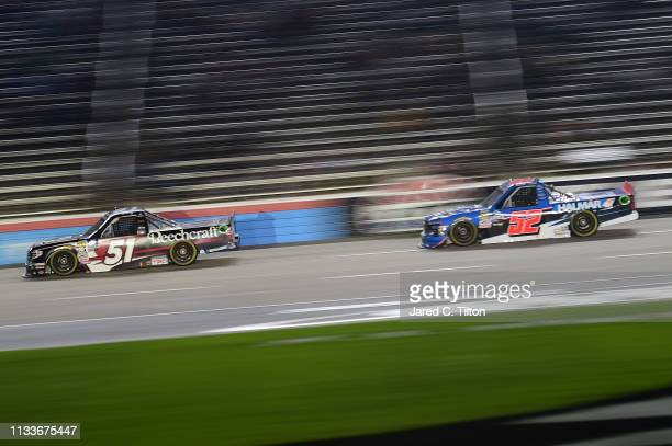 Kyle Busch driver of the Cessna Toyota races Stewart Friesen driver of the Halmar International Chevrolet during the NASCAR Gander Outdoors Truck...