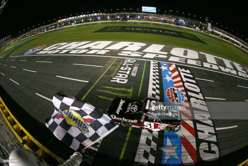 Kyle Busch, driver of the #51 Cessna Toyota, takes the checkered flag to win the Camping World Truck Series North Carolina Education Lottery 200 at Charlotte Motor Speedway on May 19, 2017 in Charlotte, North Carolina.