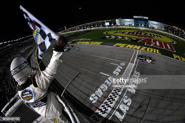 Kyle Busch driver of the Cessna Toyota takes the checkered flag to win the NASCAR Camping World Truck Series Stratosphere 200 at Las Vegas Motor...