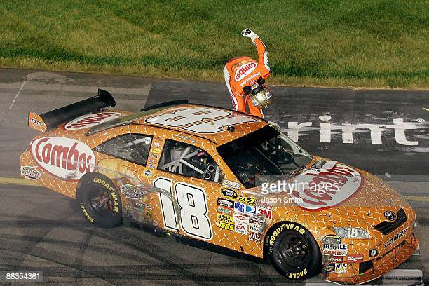 Kyle Busch driver of the Combos Toyota bows to the fans as he celebrates winning the NASCAR Sprint Cup Series Crown Royal Presents the Russ Friedman...