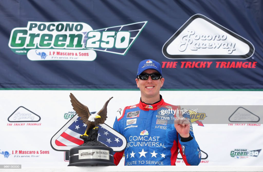 Kyle Busch, driver of the #18 Comcast Salute to Service/Juniper Toyota, poses for a photo with the trophy in Victory Lane after winning the NASCAR Xfinity Series Pocono Green 250 Recycled by J.P. Mascaro & Sons at Pocono Raceway on June 2, 2018 in Long Pond, Pennsylvania.