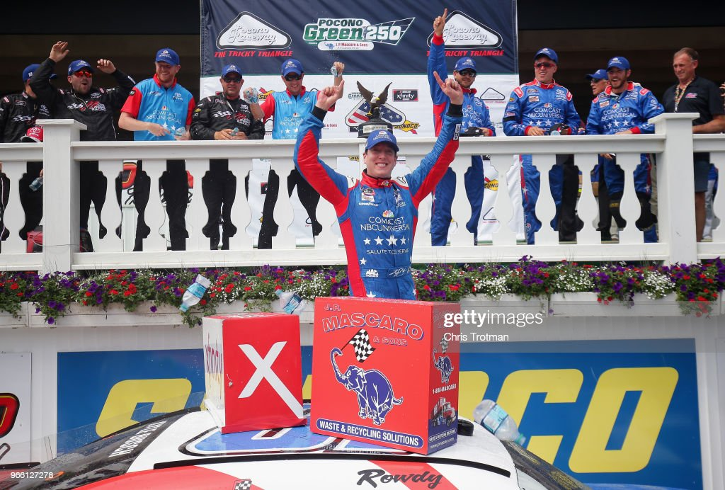 Kyle Busch, driver of the #18 Comcast Salute to Service/Juniper Toyota, celebrates in Victory Lane after winning the NASCAR Xfinity Series Pocono Green 250 Recycled by J.P. Mascaro & Sons at Pocono Raceway on June 2, 2018 in Long Pond, Pennsylvania.