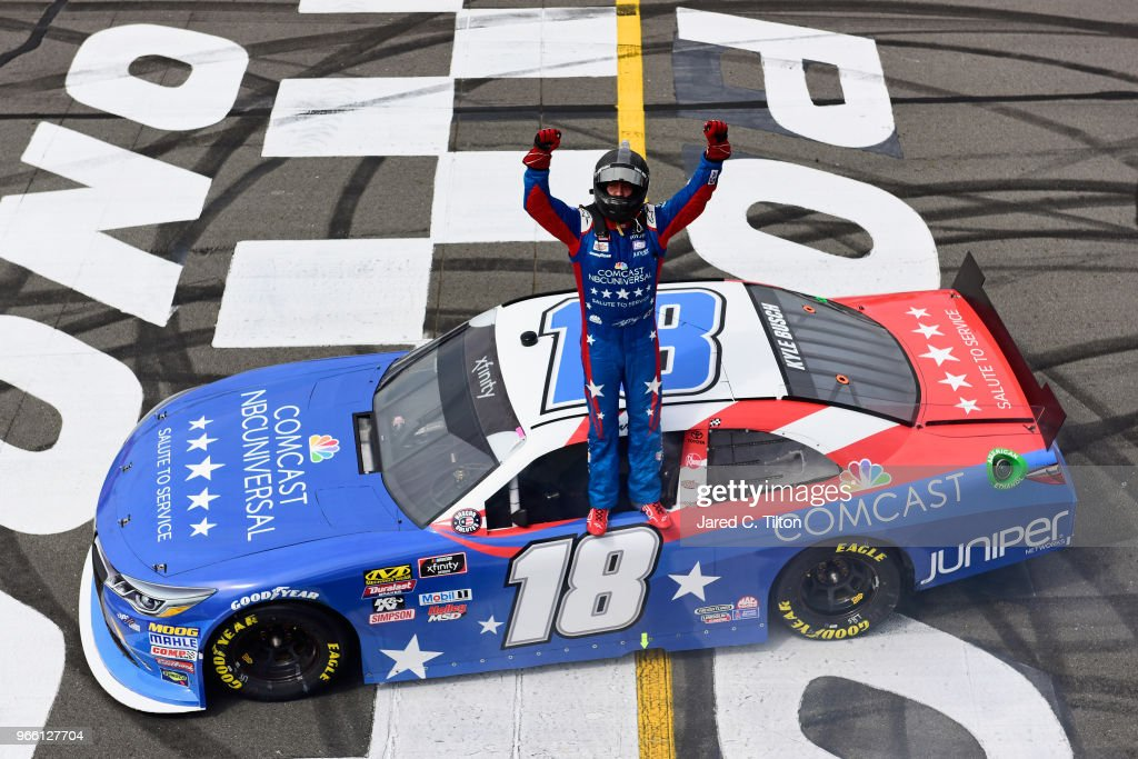 Kyle Busch, driver of the #18 Comcast Salute to Service/Juniper Toyota, celebrates after winning the NASCAR Xfinity Series Pocono Green 250 Recycled by J.P. Mascaro & Sons at Pocono Raceway on June 2, 2018 in Long Pond, Pennsylvania.