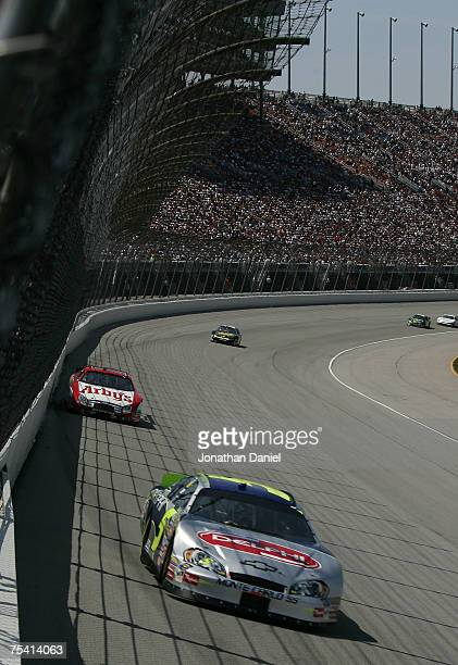 Kyle Busch driver of the DELPHI Chevrolet leads Matt Kenseth driver of the Arby's Ford during the NASCAR Busch Series USG Durock 300 at Chicagoland...