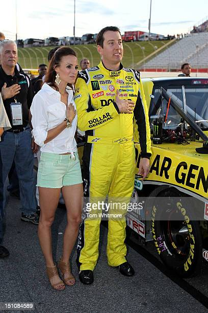 Kyle Busch driver of the Dollar General Toyota stands with his wife Samanatha for the performance of the NASCAR Camping World Truck Series Jeff...