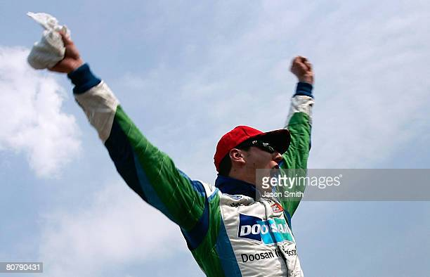 Kyle Busch driver of the Doosan Infracore Toyota celebrates winning the NASCAR Nationwide Series Corona Mexico 200 at Autodromo Hermanos Rodriguez on...