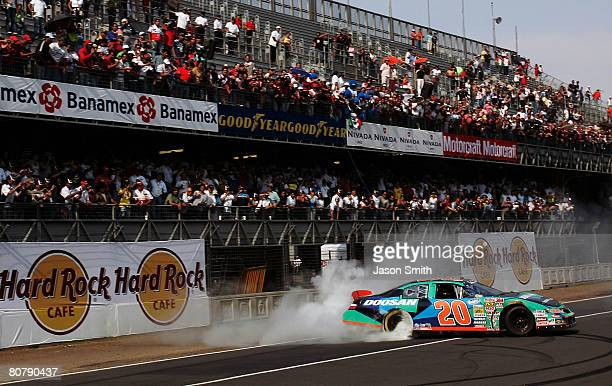 Kyle Busch driver of the Doosan Infracore Toyota performs a burnout after winning the NASCAR Nationwide Series Corona Mexico 200 at Autodromo...