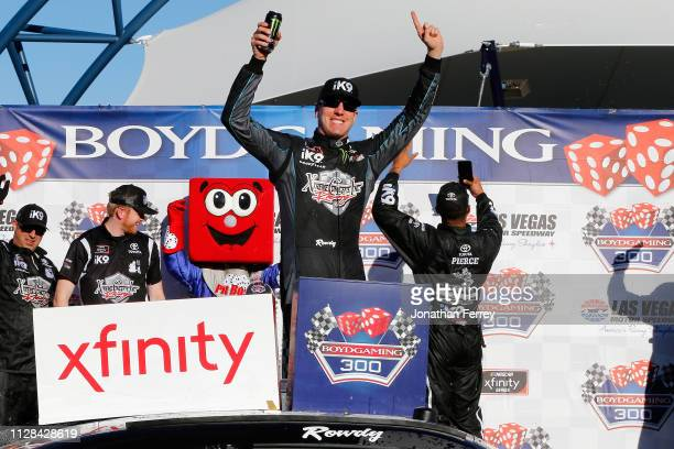 Kyle Busch driver of the Extreme Concepts/iK9 Toyota celebrates in Victory Lane after winning the NASCAR Xfinty Series Boyd Gaming 300 at Las Vegas...