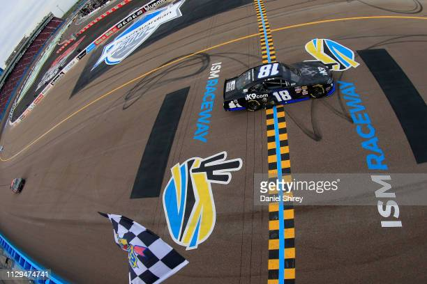 Kyle Busch, driver of the Extreme Concepts/iK9 Toyota, takes the checkered flag to win the NASCAR Xfinity Series iK9 Service Dog 200 at ISM Raceway...