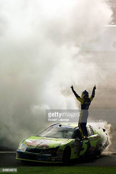 Kyle Busch, driver of the Hendrick Motorsports Kellogg's Chevrolet, celebrates after winning the NASCAR Nextel Cup Series Sony HD 500 on September 4,...