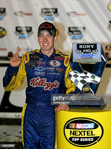 Kyle Busch, driver of the Hendrick Motorsports Kellogg's Chevrolet, poses with his trophy after winning the NASCAR Nextel Cup Series Sony HD 500 on...