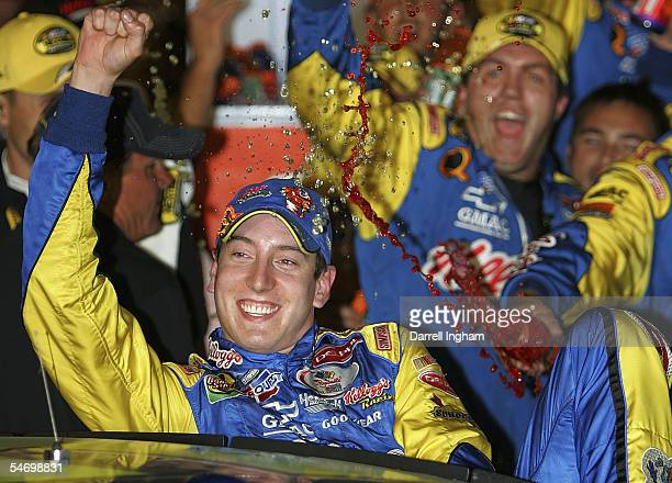 Kyle Busch driver of the Hendrick Motorsports Kellogg's Chevrolet celebrates after winning the NASCAR Nextel Cup Series Sony HD 500 on September 4...