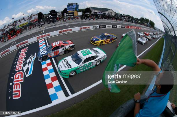 Kyle Busch, driver of the iK9 Toyota, and Austin Cindric, driver of the MoneyLion Ford, take the green flag to start the NASCAR Xfinity Series Zippo...
