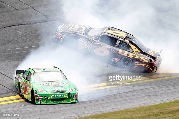 Kyle Busch driver of the Interstate Batteries Toyota and David Ragan driver of the UPS Ford spin out of control after an incident in practice for the...