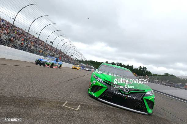 Kyle Busch, driver of the Interstate Batteries Toyota, and Martin Truex Jr., driver of the Resers Fine Foods #LetsPicnic Toyota, lead the field on a...
