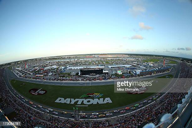 Kyle Busch driver of the Interstate Batteries Toyota and Matt Kenseth driver of the Home Depot / Husky Toyota lead the field at the start of the...