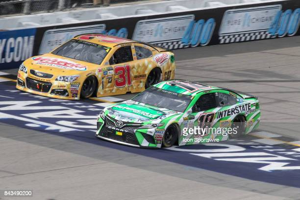Kyle Busch driver of the Interstate Batteries Toyota and Ryan Newman driver of the Velveeta Shells Cheese Chevrolet race during the Monster Energy...