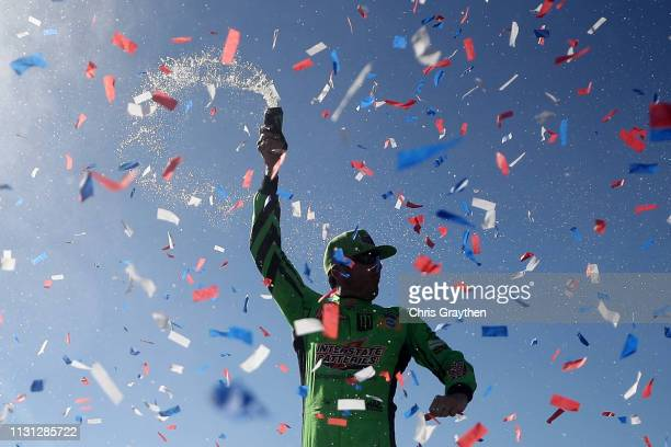 Kyle Busch, driver of the Interstate Batteries Toyota, celebrates in victory lane after winning the Monster Energy NASCAR Cup Series Auto Club 400...