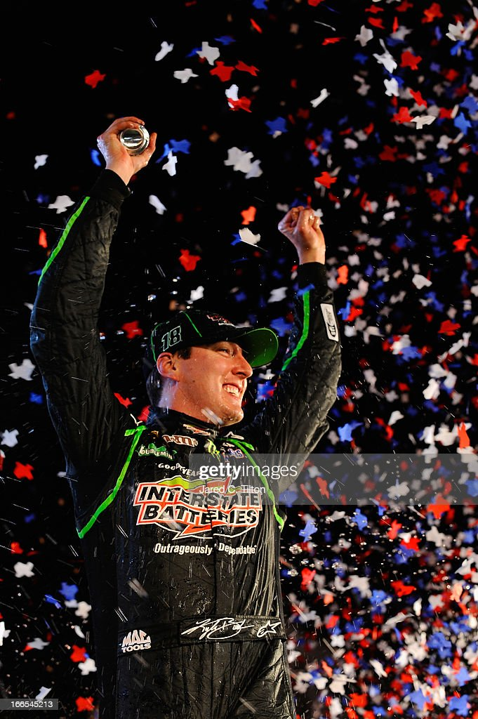 Kyle Busch, driver of the #18 Interstate Batteries Toyota, celebrates in Victory Lane after winning the NASCAR Sprint Cup Series NRA 500 at Texas Motor Speedway on April 13, 2013 in Fort Worth, Texas.