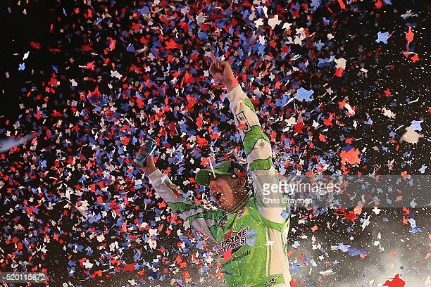 Kyle Busch driver of the Interstate Batteries Toyota celebrates in Victory Lane after winning the NASCAR Sprint Cup Series Duck Commander 500 at...