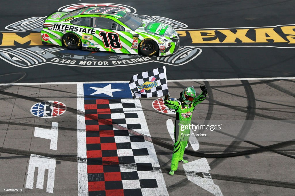 Kyle Busch, driver of the #18 Interstate Batteries Toyota, celebrates winning the Monster Energy NASCAR Cup Series O'Reilly Auto Parts 500 at Texas Motor Speedway on April 8, 2018 in Fort Worth, Texas.