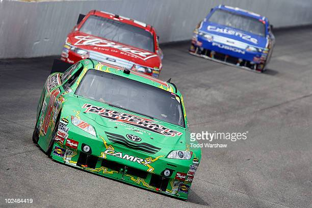 Kyle Busch driver of the Interstate Batteries Toyota leads Kasey Kahne driver of the Budweiser Ford and Kevin Conway driver of the Extenze Ford...