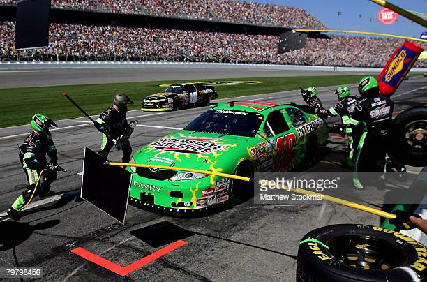 Kyle Busch, driver of the Interstate Batteries Toyota, makes a pit stop during the NASCAR Nationwide Series Camping World 300 at Daytona...