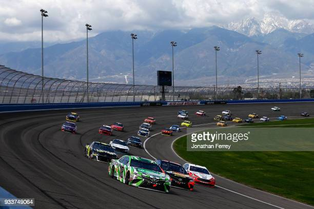 Kyle Busch, driver of the Interstate Batteries Toyota, Martin Truex Jr., driver of the Bass Pro Shops/5-hour ENERGY Toyota, and Brad Keselowski,...