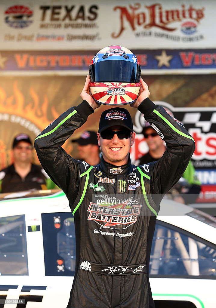 Kyle Busch, driver of the #18 Interstate Batteries Toyota, poses with the helmet Pole Award after qualifying for pole position for the NASCAR Sprint Cup Series NRA 500 at Texas Motor Speedway on April 12, 2013 in Fort Worth, Texas.