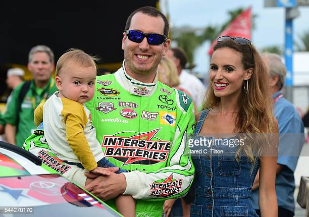 Kyle Busch driver of the Interstate Batteries Toyota stands on the grid with wife Samantha and son Brexton prior to the NASCAR Sprint Cup Series Coke...