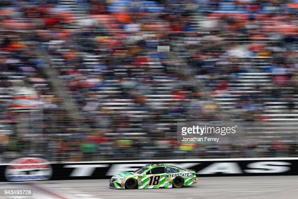 Kyle Busch driver of the Interstate Batteries Toyota takes the checkered flag to win the Monster Energy NASCAR Cup Series O'Reilly Auto Parts 500 at...