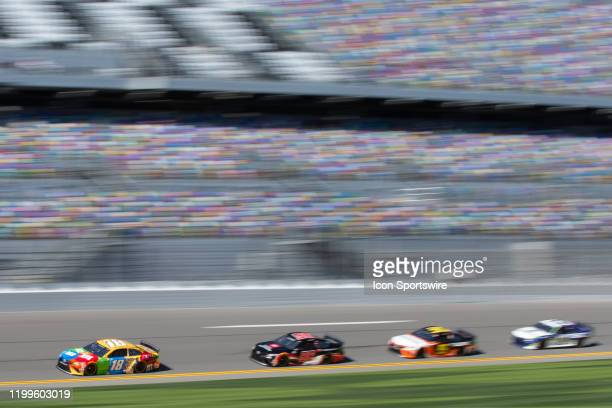 Kyle Busch driver of the Joe Gibbs Racing MMs Toyota Camry leads a pack of cars during practice for the Daytona 500 on February 8 2020 at Daytona...
