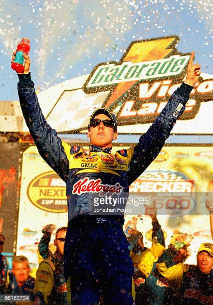 Kyle Busch driver of the Kellogg's Hendrick Motorsports Chevrolet celebrates his victory during the NASCAR Nextel Cup Checker Auto Parts 500 on...