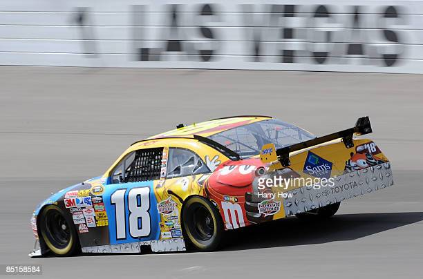 Kyle Busch driver of the M M's Toyota drives during practice for the NASCAR Sprint Cup Series Shelby 427 at the Las Vegas Motor Speedway on February...