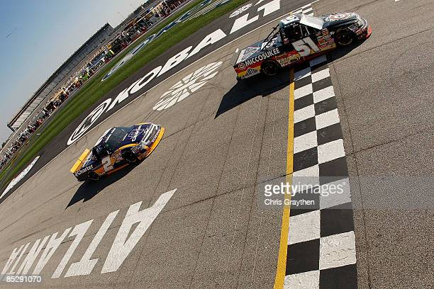 Kyle Busch, driver of the Miccosukee Resort Toyota crosses the finish line to win during the NASCAR Craftsman Truck Series American Commercial Lines...