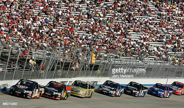 Kyle Busch driver of the Miccosukee Resort Toyota leads a group of trucks during the NASCAR Camping World Truck Series AAA Insurance 200 at Dover...