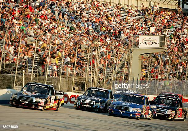 Kyle Busch driver of the Miccosukee Resort Toyota leads a group of trucks for a restart during the NASCAR Camping World Truck Series AAA Insurance...