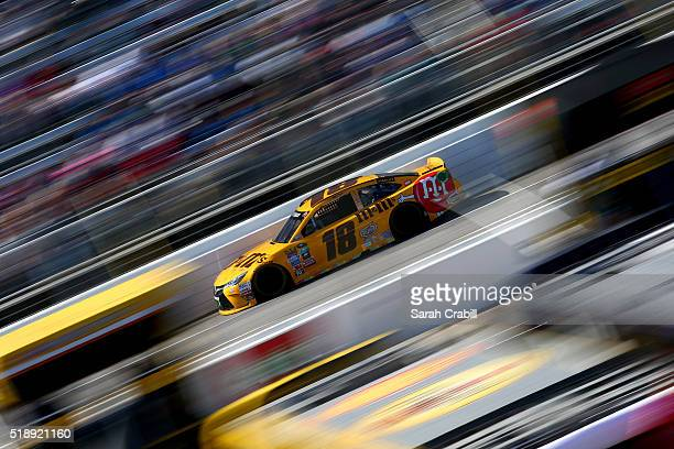 Kyle Busch driver of the MM's 75th Anniversary Toyota races during the NASCAR Sprint Cup Series STP 500 at Martinsville Speedway on April 3 2016 in...