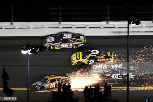 Kyle Busch, driver of the M&M's Brown Toyota, spins out of crontrol as Jimmie Johnson, driver of the Lowe's Chevrolet, Marcos Ambrose, driver of the...