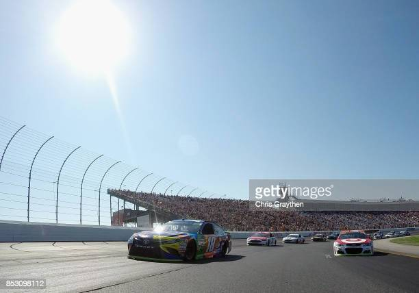 Kyle Busch, driver of the M&M's Caramel Toyota, and Kyle Larson, driver of the Target Chevrolet, lead the field under pace laps prior to the start of...