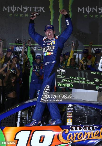 Kyle Busch driver of the MM's Caramel Toyota celebrates in victory lane after winning the Monster Energy NASCAR All Star Race at Charlotte Motor...